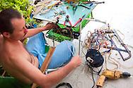 Re-wiring a car in Holguin, Cuba.