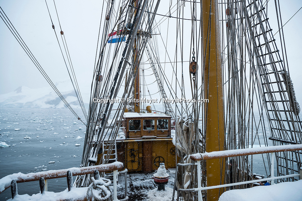 Antarctica, February 2016. Winter fun with 10cm of 'Antarctic Summer' snow on deck. Cierva Cove, in Huges Bay, which is framed at its head by glacial front of the superb Brequet Glacier, and it's a place used by several species of seals to fish, hunt and rest on the ice floes. Dutch Tallship, Bark Europa, explores Antarctica during a 25 day sailing expedition. Photo by Frits Meyst / MeystPhoto.com