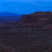 Panoramic view shortly after sunset of Shafer Canyon and Shafer Trail Road near the Canyonlands National Park visitor center. The LaSal Mountains are visible in the background. WATERMARKS WILL NOT APPEAR ON PRINTS OR LICENSED IMAGES.