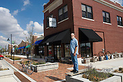 "Greensburg, Kansas, USA..Antique shop owner Gary Goodman in front of his bulding  on Main Street , which he bought from the Centera Bank. The building was one of the few structures surviving the tornado. Centera Bank built a new branch across the street...""Greensburg: Better, Stronger, Greener!"".On May 4, 2007, an EF5 tornado cut a 1.7-mile path of destruction through Greensburg, Kansas. Winds reaching speeds of 205 miles per hour uprooted trees, demolished homes and leveled the town. Eleven people died and 95% of the buildings were destroyed beyond repair. Residents have since worked furiously to rebuild it in a way that is both economically and environmentally sustainable and to meet the highest environmental standards. Greensburg, whose population has dropped from about 1400 to 800 following the storm and is now growing again, is currently the greenest town in America and the first in the United States to pass a resolution to certify that all city-owned buildings earn LEED Platinum accreditation, the highest level of the LEED rating system...Foto © Stefan Falke"