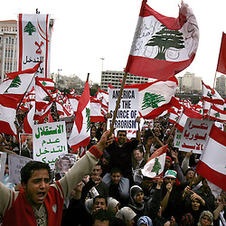 Protesters are seen in Beirut, Lebanon, March 8, 2005. Hundreds of thousands of pro-Syrian protesters gather and chant anti-American slogans. Hezbollah, the militant Shiite Muslim group, called for a nationwide demonstration against foreign intervention and to counter weeks of massive anti-Syrian rallies.