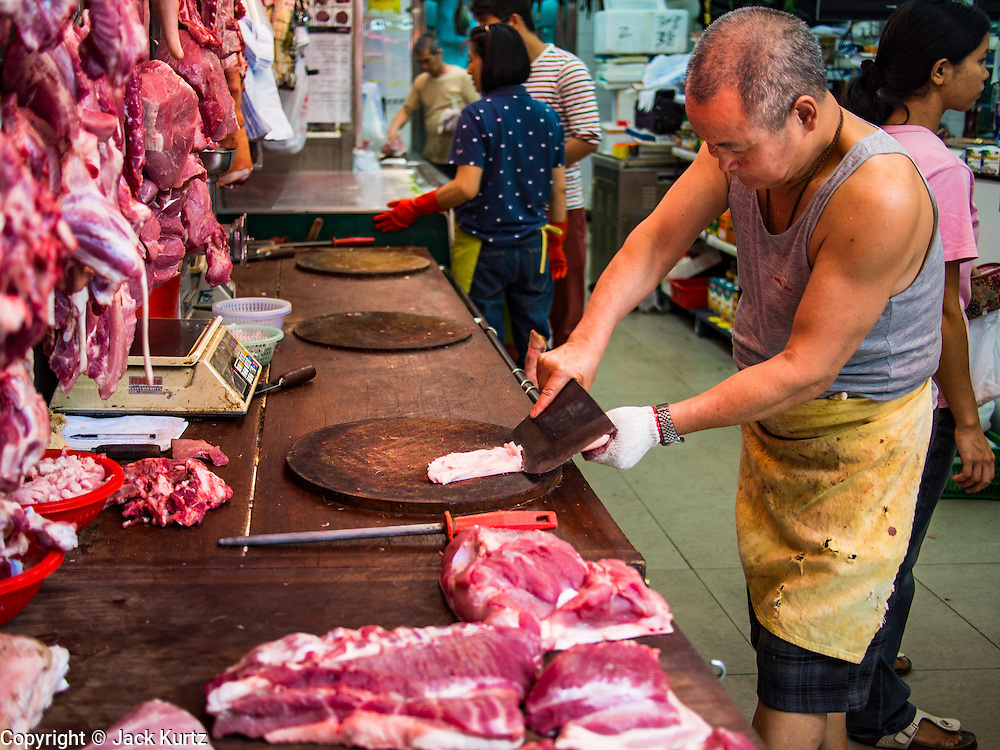 10 AUGUST 2013 - HONG KONG:   A butcher shop in Hong Kong. Hong Kong is one of the two Special Administrative Regions of the People's Republic of China, Macau is the other. It is situated on China's south coast and, enclosed by the Pearl River Delta and South China Sea, it is known for its skyline and deep natural harbour. Hong Kong is one of the most densely populated areas in the world, the  population is 93.6% ethnic Chinese and 6.4% from other groups. The Han Chinese majority originate mainly from the cities of Guangzhou and Taishan in the neighbouring Guangdong province.      PHOTO BY JACK KURTZ