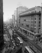 "Known as ""The Roar of the Four"" Market Street was once home to four lanes of streetcar traffic. This is a view east down Market Street from Kearny Street at 8:33 AM 