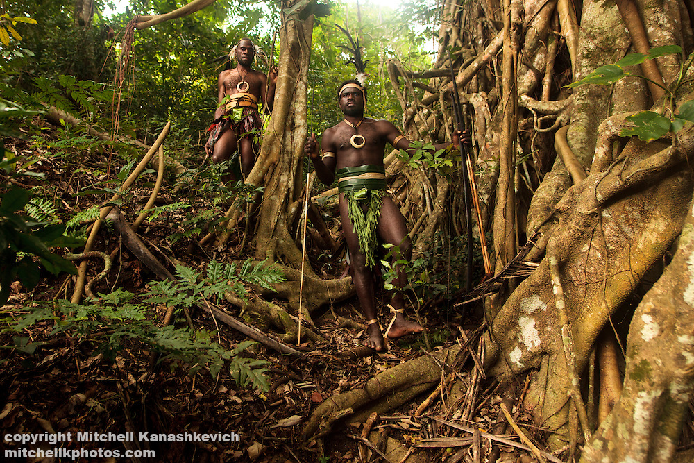 Two young tribal chiefs pose for a portrait near a Banyan tree near the village of Wintua South West Bay, Malekula, Vanuatu