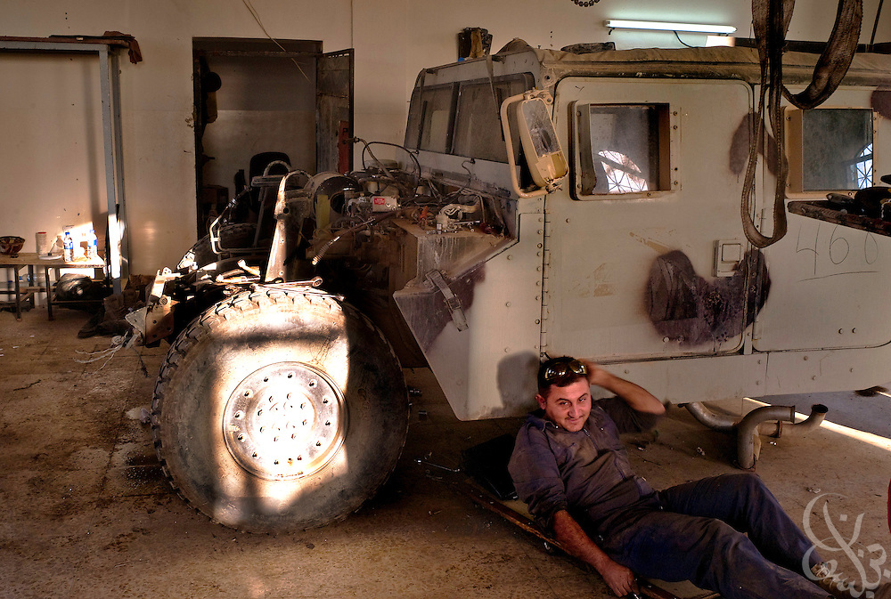 Iraqi Army 2nd Division mechanics work to repair Iraqi army humvees at their forward operating base in Mosul, Iraq October 17, 2007. Although Iraqi security forces are handling day-to-day security tasks across Mosul, they still rely on some help from U.S. forces with regard to basic military things such as logistics, spare parts or air support.