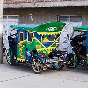 Mototaxis (three-wheeled auto rickshaws) provide cheap public transportation in Huaraz, in the Andes Mountains, Ancash Region, Peru, South America.