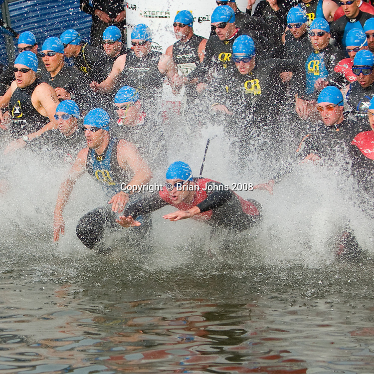 The age-group men make an explosive start on the long course at the 2005 Wildflower Triathlon Festival.  The half-Ironman distance will take the winners around 5 hours to finish.