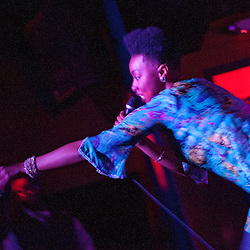"Washington, DC  - Carolyn Malachi grabs a cell phone from the audience and weaves a rhyme about it at Tropicalia for the ""Sleepless in Soweto"" album release party."