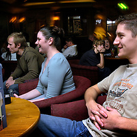 Family enjoying the indoor entertainment and having drinks in the Alton Towers Hotel Bar, Alton Towers, UK..Photo©Steve Forrest/Workers' Photos.