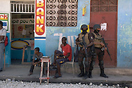 Haitian SWAT assist in an arrest operation in the Cité-de-Dieu neighbourhood of Port-au-Prince, one of many arrest operations condemned by local and international human rights organizations. Concordia Media Gallery, Montreal, 2010.