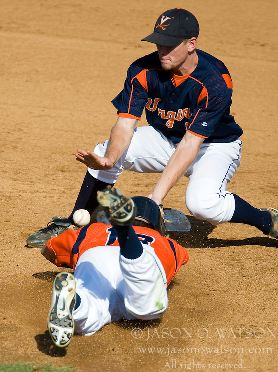 Virginia Cavaliers OF Jarrett Parker (13) steals second wtih Virginia Cavaliers INF John Weaver (6) defending.  The Virginia Cavaliers baseball team held a seven game Orange and Blue World Series at Davenport Field in Charlottesville, VA.  Images are from Game 6 held on October 22, 2007.