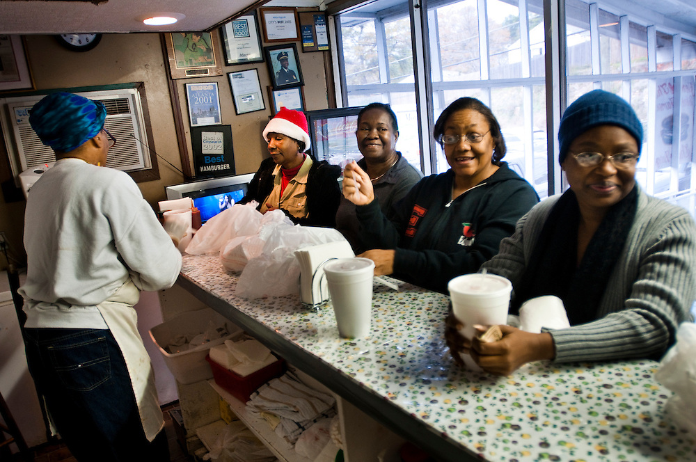 "Patrons (from left Mari Arnold, 61,.Willie Yarbron, 60 Pamela Ferguson). waiting for their burgers at Ann's Snack Bar...Ann's Snack Bar in the Atlanta neighborhood Kirkwood..The small restaurant is owned and operated by Ann Price, known to patrons as ""Miss Ann"" and has been in operation since 1973.  The house special is called the ""Ghetto Burger"", a double bacon chili cheeseburger with a secret ingredient.Wall Street Journal named the Ghetto Burger the best hamburger in America."