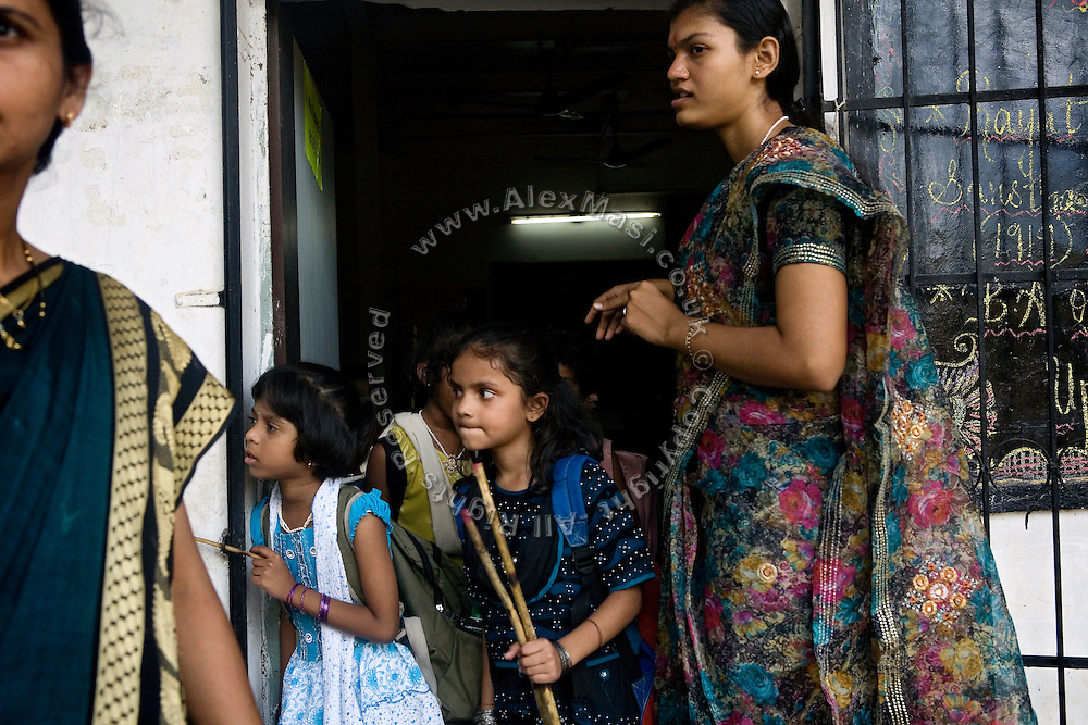Children are about to leave class after a day spent a school run by Sonrisas de Bombay, a fast-growing Spanish NGO in Mumbai, India.A leprosy patient is talking to a doctor at the clinic supported by Sonrisas de Bombay, a fast-growing Spanish NGO in Mumbai, India.