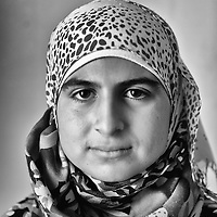 Egypt / Syrian refugees / Syrian refugee Maha Shabalot, 14-years-old, from Homs poses for a photograph in Beit Al Alia neighborhood in the 6th of October City outside of Cairo, Egypt, Tuesday, May 28, 2013. Maha, who arrived 10 days ago, lives in a small 2 room apartment with her mother and 2 siblings and other family members. Maha's mother Khadiga moustafa said, 'I was worried about my children and I was afraid of the bombings. We couldn't sleep and we were always stressed'.   / UNHCR / Shawn Baldwin / May 2013