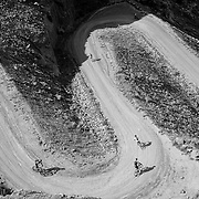 SHOT 10/14/16 2:06:08 PM - Mountain bikers descend the Horsethief Trail section of the White Rim Trail. The White Rim is a mountain biking trip in Canyonlands National Park just outside of Moab, Utah. The White Rim Road is a 71.2-mile-long unpaved four-wheel drive road that traverses the top of the White Rim Sandstone formation below the Island in the Sky mesa of Canyonlands National Park in southern Utah in the United States. The road was constructed in the 1950s by the Atomic Energy Commission to provide access for individual prospectors intent on mining uranium deposits for use in nuclear weapons production during the Cold War. Four-wheel drive vehicles and mountain bikes are the most common modes of transport though horseback riding and hiking are also permitted.<br /> (Photo by Marc Piscotty / &copy; 2016)