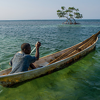 Fisherman at Roatán, located between the islands of Útila and Guanaja, the largest of Honduras' Bay Islands.  Rising sea levels may affect the ability to live on such islands.