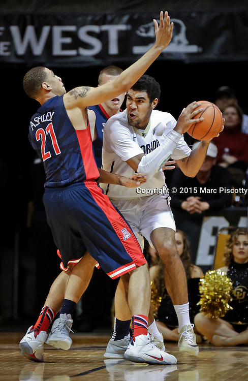 SHOT 2/26/15 9:16:32 PM - Arizona's Brandon Ashley #21and T.J. McConnell #4 surround Colorado's Josh Scott #40 during their regular season Pac-12 basketball game at the Coors Events Center in Boulder, Co. Arizona won the game 82-54.<br /> (Photo by Marc Piscotty / &copy; 2015)