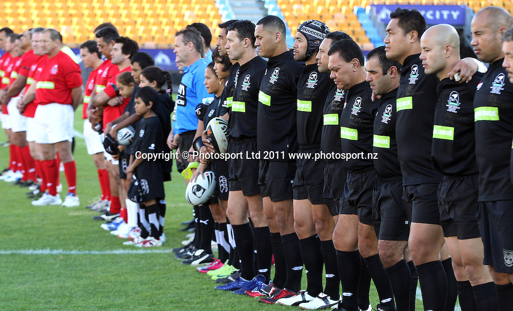 Teams line up for a minutes silence. Australia and New Zealand Legends of League Christchurch Earthquake Appeal Match, Mt Smart Stadium, Auckland, New Zealand, Thursday 10 March 2011. <br />