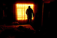 An Iraqi army soldier checks a house in the Qubbah village, Iraq, Feb., 2, 2007 during Operation Lightning. Operation Lightning is an Iraqi army planned operation looking for weapon cache, personnel of high interest and gathering of intelligence with the help of the U.S. Army Soldiers from Forward Operating Base McHenry, soldiers are from 2nd Battalion, 27th Infantry Regiment, 3rd Brigade Combat Team, 25th Infantry Division, Schofield Barracks, Hawaii. The Iraqi soldier is assigned to the 1st Battalion, 2nd Brigade, 4th Infantry.