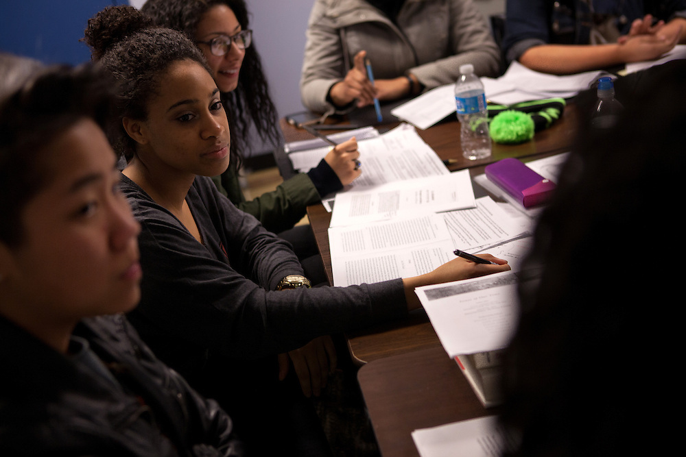 From left: Suzanne Sim, 18, Sydney Lewis, 17 and Denisse Abreu, 17, from the De Pauw Posse 11, debate viewpoints during a writing workshop at the Posse Foundation in New York, NY on April 01, 2014.Students in the Posse Foundation are chosen as scholars and go through college prep together as seniors in high school then attend the same college campus together where they get ongoing support. The Posse Foundation has identified, recruited and trained 5,544 public high school students with extraordinary academic and leadership potential to become Posse Scholars over the past 25 years.