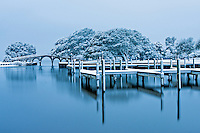 Picture of docks and bridge in the snow at the Whalehead Club in Corolla NC.