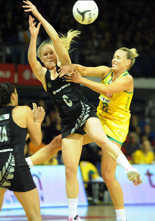 New Zealand's Laura Langman, left, contests the ball with Australia's Kin Green in the Constellation Cup International netball game at The Trusts Arena, Waitakere, Auckland, New Zealand, Wednesday, October 15, 2014. Credit:SNPA / Ross Setford