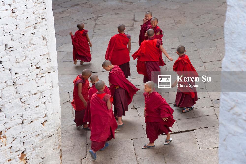 Monks in red robe inside Paro Dzong, Paro, Bhutan