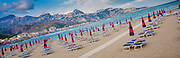 Umbrellas and chairs lined up on an empty beach, Giardini Naxos, Sicily, Italy