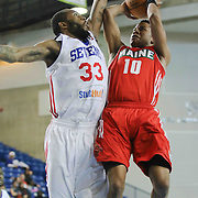 Maine Red Claws Guard Tim Frazier (10) drives towards the basket as Delaware 87ers Forward Kenny Hall (33) defends in the first half of a NBA D-league regular season basketball game between the Delaware 87ers and the Maine Red Claws (Boston Celtics) Friday, Dec. 12, 2014 at The Bob Carpenter Sports Convocation Center in Newark, DEL
