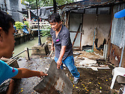 06 OCTOBER 2016 - BANGKOK, THAILAND:  Demolition workers take apart a home in the Pom Mahakan community. Evictions are continuing at a slow pace in Pom Mahakan Fort and as people move out their homes are destroyed to ensure new squatters don't move in. More than 40 families still live in the Pom Mahakan Fort community. Bangkok officials are trying to move them out of the fort and community leaders are barricading themselves in the fort. The residents of the historic fort are joined almost every day by community activists from around Bangkok who support their efforts to stay. City officials said recently that they expect to have the old fort cleared of residents and construction on the new park started by the end of 2016.     PHOTO BY JACK KURTZ