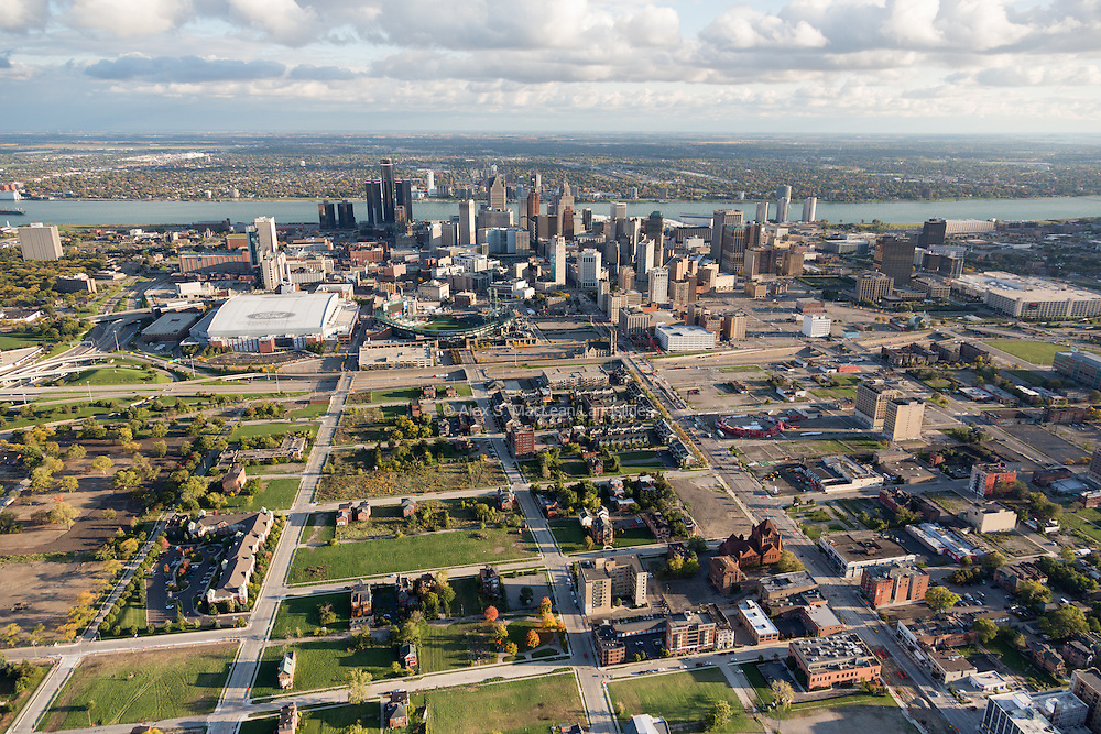 An overview of Brush Park and its proximity to downtown, including the Detroit River and Canada on the horizon. New housing developments begin to fill in along the edge of the neighborhood.