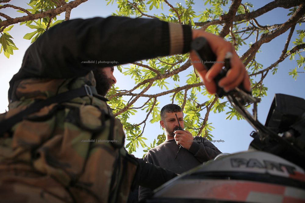 FSA rebels on standby during the UN broked ceasefire in Courine. Courine was been attacked by ground troops on February 22, 2012 (see archive images). aftermath air force helicopters shot  rockets several times into the 7000 inhabitants counting village south of Idlib city. Courine ist still a stronghold of opposition.