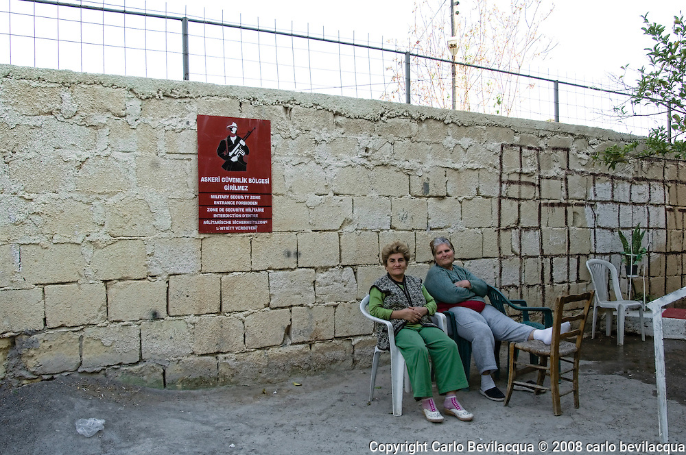 Turkish Inmigrant Old Women Chilling Up Near military wall