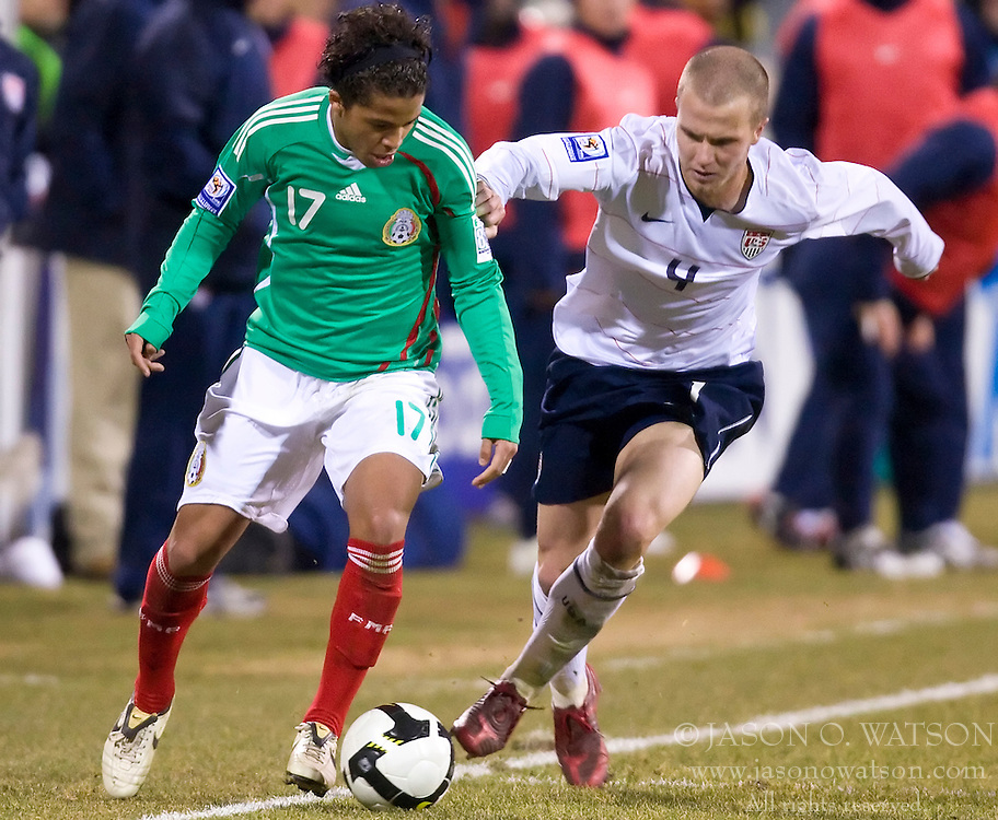 United States midfielder Michael Bradley (4) battles with Mexico forward Giovani dos Santos (17).  The United States men's soccer team defeated the Mexican national team 2-0 in CONCACAF final group qualifying for the 2010 World Cup at Columbus Crew Stadium in Columbus, Ohio on February 11, 2009.