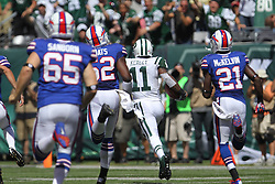Sept 9, 2012; East Rutherford, NJ, USA; New York Jets wide receiver Jeremy Kerley (11) returns a punt for a touchdown while being chased by Buffalo Bills cornerback Leodis McKelvin (21) during the first half at MetLIfe Stadium.