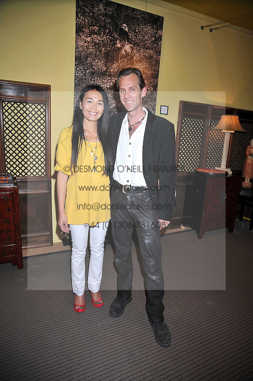 Photographer JOTH SHAKERLEY with his wife SONIA at a party to celebrate the publication of Joth Shakerley's book 'Pregnant Women' held at 598a Kings Road, London SW6 on 20th May 2009.