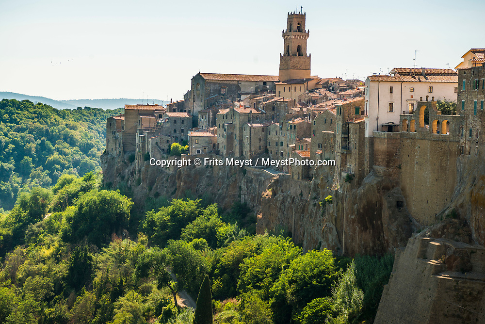 Pitigliano, Maremma, Tuscany, Italy, July 2016.  Pitigliano is located in Tuscany halfway from Florence and Rome, perched atop a volcanic tufa ridge. Its unmistakable skyline makes it stand out from kilometres away and gives Pitigliano a surreal charm. It is also known as Little Jerusalem (Piccola Gerusalemme) due to the long-standing presence of a Jewish community. Prior to this particular part of history, Pitigliano has an ancient past, with centuries of changes in civilizations and cultures. The shoreline of Tuscany is at its best in the Maremma region; the name derives from Marittima, referring to the rugged coastal strip and inland hills of the Grosseto, Tuscany's southernmost province.  Photo by Frits Meyst / MeystPhoto.com