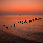 A fisherman heads home at sunset on the Gulf of Thailand near Kep, Cambodia.