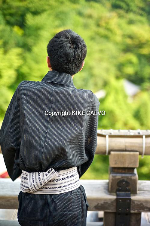 Man in traditional clothing at Kiyomizu-dera temple.