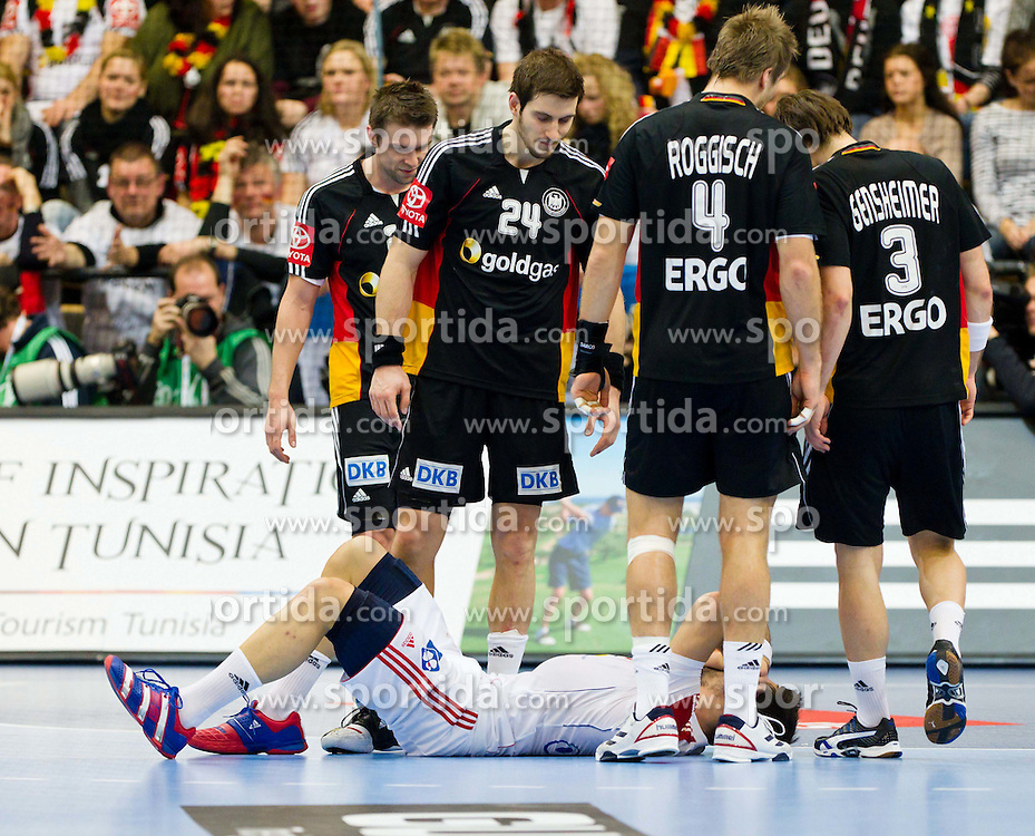 19.01.2011, Kristianstad Arena, SWE, IHF Handball Weltmeisterschaft 2011, Herren, Deutschland (GER) vs Frankreich (FRA) im Bild, // Frankrike France 13 Nikola Karabatic has been knocked down by german players // during the IHF 2011 World Men's Handball Championship match  Germany (GER) vs France (FRA) at Kristianstad Arena, Sweden on 19/1/2011.  EXPA Pictures © 2011, PhotoCredit: EXPA/ Skycam/ Johansson +++++ ATTENTION - OUT OF SWEDEN/SWE +++++