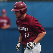 Saint Joseph's Outfielder John Brue (13) trouts around the base after crushing a home run to right field during a regular season baseball game between Delaware and Saint Joseph's at Bob Hannah Stadium Tuesday April 19, 2016, in Newark.