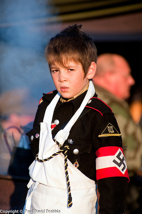 A young reenactor dressed as a member of the Nazi Hitler Youth<br /> 15th October 2011<br /> Image &copy; Paul David Drabble