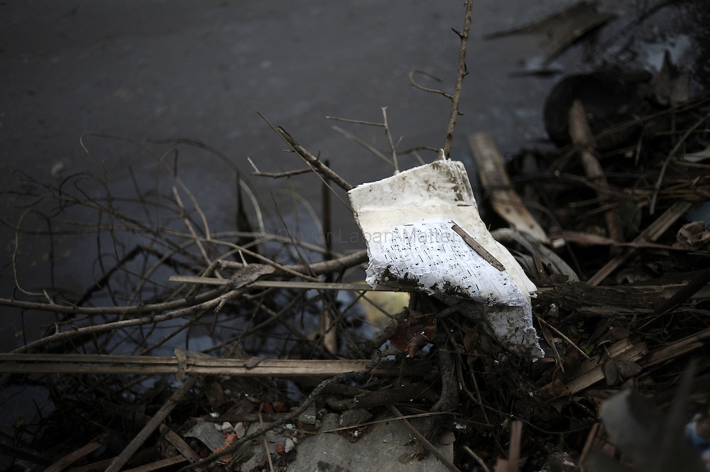 A music sheet is seen in the wreckage of a house in the village of Kayadaung on May 23, 2008 in the isolated area of Kanzeik in the Irrawaddy Delta region -- an area only accessible by boat which has received neither government nor foreign aid. Voters in regions devastated by the cyclone, many hungry and destitute, cast ballots on May 24 in a referendum that many said was meaningless because Myanmar's junta has already declared victory.