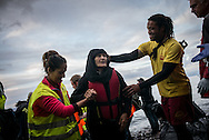 A eldery migrants women is helped to reach a makeshift camp after hes boat crossed the Aegean sea from Turkey. FEDERICO SCOPPA/CAPTA