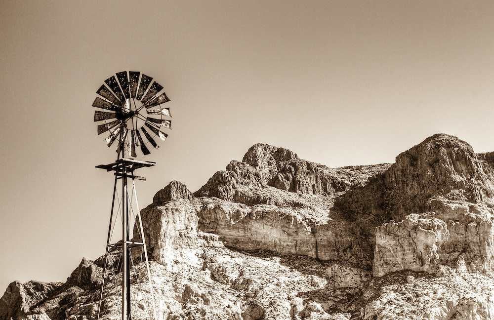 Aged windmill infront of mountains