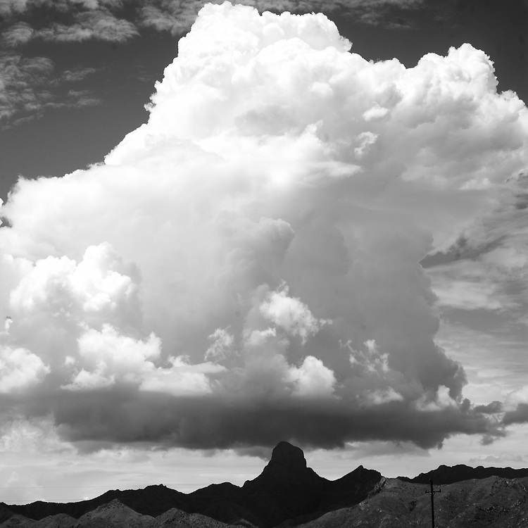 A cloud sits over Baboquivari Peak on Sunday, July 13, 2008 near Sasabe, AZ.