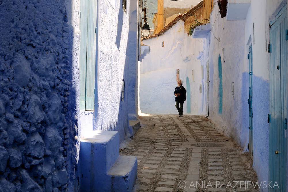 Morocco, Chefchaouen. Child coming back from school.