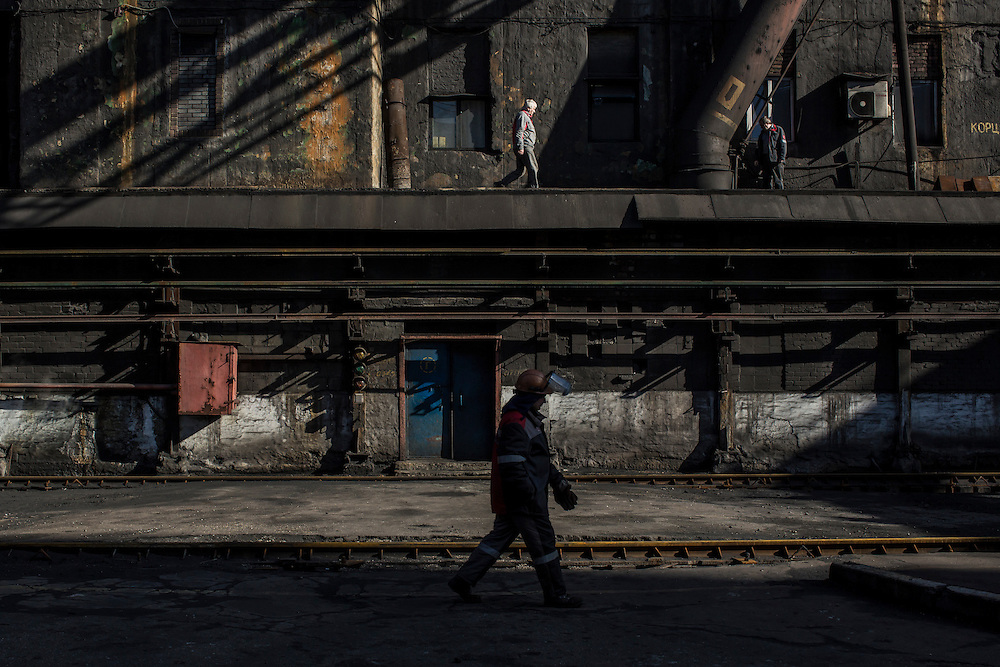 Workers at the Avdiivka Coke Plant on Tuesday, February 16, 2016 in Avdiivka, Ukraine. The factory produces coke from local coal for use in Ukrainian steel production.