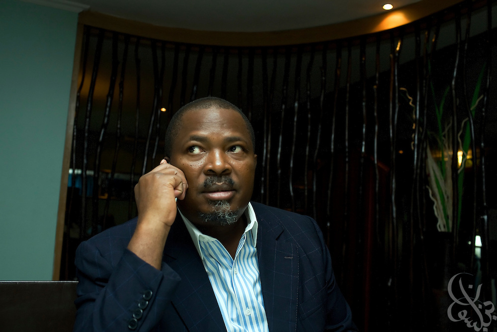 ThisDay newspaper Editor-in-Chief, and Nigerian media mogul Nduka Obaigbena takes a steady stream of business calls during a July 14, 2008 dinner in Lagos, Nigeria. Obaigbena founded the ThisDay music and fashion festival three years ago as an an annual effort to raise awareness of African issues while promoting positive images of Africa using music, fashion and culture in a series of concerts and events in Nigeria, the United States and the United Kingdom.