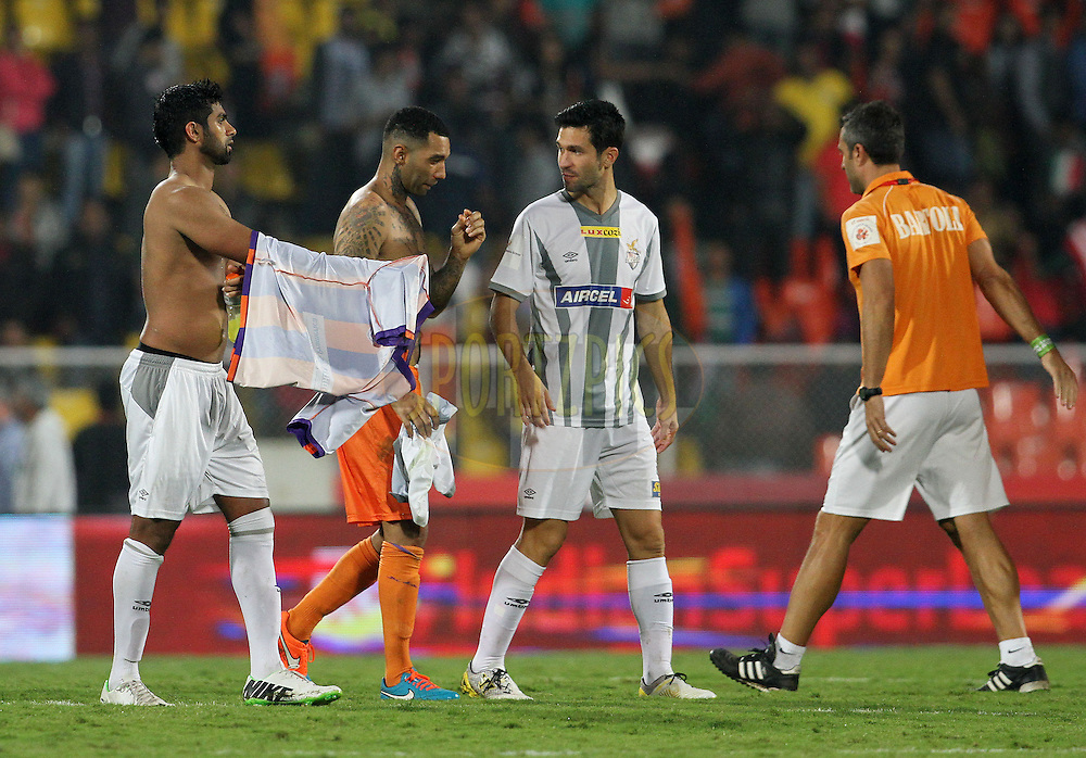 Luis Javier Garcia Sanz of Atletico de Kolkata  speaks with Jermaine Pennant of FC Pune City after the match 44 of the Hero Indian Super League between FC Pune City and Atletico de Kolkata FC held at the Shree Shiv Chhatrapati Sports Complex Stadium, Pune, India on the 29th November 2014.<br /> <br /> Photo by:  Vipin Pawar/ ISL/ SPORTZPICS